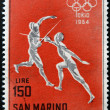 Stock Photo: SAN MARINO - CIRC1964: stamp printed in SMarino shows fencing, 18th Olympic Games, Tokyo, circ1964