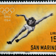 Stock Photo: SAN MARINO - CIRC1964: stamp printed in SMarino shows athlete, 18th Olympic Games, Tokyo, circ1964