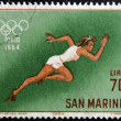 Stock Photo: SAN MARINO - CIRC1964: stamp printed in SMarino shows athlete running, 18th Olympic Games, Tokyo, circ1964