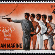 Stock Photo: SAN MARINO - CIRC1964: stamp printed in SMarino shows different athletes, 18th Olympic Games, Tokyo, circ1964