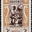 图库照片: DAHOMEY CIRC1961: stamp printed in Dahomey shows Wood sculptor, circ1961