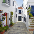 Townhouses along a typical whitewashed village street, Frigiliana, Spain — Stock Photo