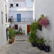 Townhouses along a typical whitewashed village street, Frigiliana, Andalusia - Stock Photo