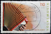 GERMANY- CIRCA 2001: stamp printed in Germany dedicated to Folk Music shows accordion, circa 2001. — Стоковое фото