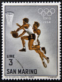 SAN MARINO - CIRCA 1964: A stamp printed in San Marino shows Basketball, 18th Olympic Games, Tokyo, circa 1964 — Stock Photo