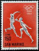 SAN MARINO - CIRCA 1964: A stamp printed in San Marino shows fencing, 18th Olympic Games, Tokyo, circa 1964 — Stock Photo