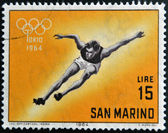 SAN MARINO - CIRCA 1964: A stamp printed in San Marino shows athlete, 18th Olympic Games, Tokyo, circa 1964 — Stock Photo