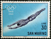SAN MARINO - CIRCA 1964: A stamp printed in San Marino shows swimming, 18th Olympic Games, Tokyo, circa 1964 — Stock Photo