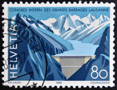 SWITZERLAND - CIRCA 1985: A stamp printed in Switzerland dedicated to the International Congress on Large Dams, Lausanne, shown Grande Dizence Dam, Canton Valais, circa 1985 — Foto Stock