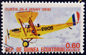 """EQUATORIAL GUINEA - CIRCA 1974: A stamp printed in Guinea dedicated to history of aviation shows Curtiss JN-4 """"Jenny"""", 1918, circa 1974 — Stock Photo"""