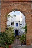 Entry into Townhouses along a typical whitewashed village street, Frigiliana, Spain — Stock Photo