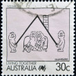 AUSTRALI- CIRC1988: Stamp printed in Australishows Caricature of Welfare, Cartoon, circ1988 — 图库照片 #25483835