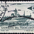 ITALY - CIRCA 1971: stamp printed in Italy shows Packet Tirrenia and postal ensign, circa 1971 — Stock Photo