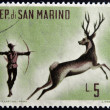 Stock Photo: SAN MARINO - CIRC1961: stamp printed in SMarino dedicated to hunting, shows Archery deer hunting, circ1961