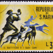 Stock Photo: SAN MARINO - CIRC1961: stamp printed in SMarino dedicated to hunting, shows batter and his dogs, circ1961
