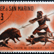 Stock Photo: SAN MARINO - CIRC1961: stamp printed in SMarino dedicated to hunting, shows Wild boar hunt, circ1961