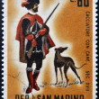 Stock Photo: SAN MARINO - CIRC1961: stamp printed in SMarino dedicated to hunting, shows Hunter with dog, circ1961