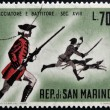 Stock Photo: SAN MARINO - CIRC1961: stamp printed in SMarino dedicated to hunting, shows hunter and beater, circ1961