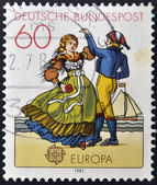 GERMANY - CIRCA 1981: a stamp printed in Germany shows North German couple dancing in regional costumes, circa 1981 — Stock Photo