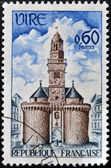 FRANCE - CIRCA 1967: A stamp printed in France shows Vire, The Gate and Clock Tower, circa 1967 — Stock Photo