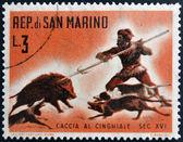 SAN MARINO - CIRCA 1961: A stamp printed in San Marino dedicated to hunting, shows Wild boar hunt, circa 1961 — Zdjęcie stockowe
