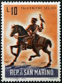 SAN MARINO - CIRCA 1961: A stamp printed in San Marino dedicated to hunting, shows Mounted falconer, circa 1961 — Stock Photo