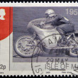 ISLE OF MAN - CIRCA 2009: A stamp printed in Isle of Man dedicated to racing motorcycles of the 50, circa 2009 - Stock Photo