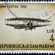 Stock Photo: SAN MARINO - CIRC1962: stamp printed in SMarino shows airplane by Glenn Curtiss, 1908, circ1962