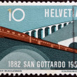 SWITZERLAND - CIRC1957: stamp printed in Switzerland shows train leaving tunnel, circ1957 — Stok Fotoğraf #26199425