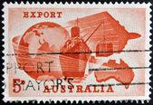 AUSTRALIA - CIRCA 1963: A stamp printed in Australia dedicated to Importance of exports to Australian economy shows Globe, Ship, Plane and Map of Australia, circa 1963 — Stock Photo