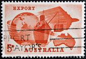 AUSTRALIA - CIRCA 1963: A stamp printed in Australia dedicated to Importance of exports to Australian economy shows Globe, Ship, Plane and Map of Australia, circa 1963 — Stock Photo
