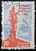 BRAZIL - CIRCA 1965: Stamp printed in Brazil dedicated to IV Centenary of the City of Rio de Janeiro, shows statue of St. Sebastian, patron saint of Rio de Janeiro, on the square Luis Camoes — Foto Stock