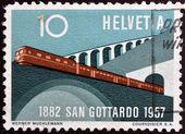 SWITZERLAND - CIRCA 1957: A stamp printed in Switzerland shows train leaving the tunnel, circa 1957 — ストック写真
