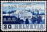 SWITZERLAND - CIRCA 1938: a stamp printed in Switzerland shows Palace of League of Nations, Geneva, circa 1938 — Stock Photo