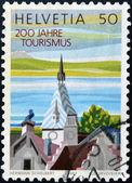 SWITZERLAND - CIRCA 1987: A stamp printed in Switzerland commemorating the 200 years of tourism, circa 1987 — Stock Photo