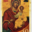 CYPRUS - CIRCA 2005: A stamp printed in Cyprus shows The Virgin Mary Karmiotissa, from the church with the same name in the village of Karmi, circa 2005 — Stock Photo #26375351