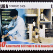 CUBA - CIRCA 2009: A stamp printed in cuba dedicated to 50 anniversary of the triumph of the revolution, shows physician and family nurse, circa 2009 — Stock Photo