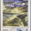 PAPUA NEW GUINEA - CIRCA 1987: A stamp printed in Papua shows A british norman islander in flight over the Northern Province of Papua New Guinea, circa 1987 — Stock Photo