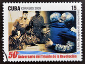 CUBA - CIRCA 2009: A stamp printed in cuba dedicated to 50 anniversary of the triumph of the revolution, shows anniversary of the demise of apartheid, embrace between Fidel and Mandela, circa 2009 — Stock Photo