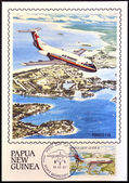 PAPUA NEW GUINEA - CIRCA 1987: A stamp printed in Papua shows A Fokker F28 in flight over of Madang township in the Madang Province, circa 1987 — Stock Photo