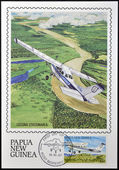 PAPUA NEW GUINEA - CIRCA 1987: A stamp printed in Papua shows A Cessna Stationair in flight over of Momase Region, circa 1987 — Stock Photo