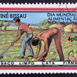 GUINEA BISSAU - CIRCA 1983: a stamp printed in the Republic of Guinea-Bissau commemorative the world food day, showing farmers plowing the land, circa 1983. — Stock Photo