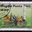 """HUNGARY - CIRCA 1979: A stamp printed in Hungary shows emblem of International Transport Exhibition and Stephenson """"Rocket"""", 1829, circa 1979 — Stock Photo"""