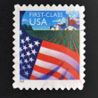 UNITED STATES OF AMERICA - CIRCA 2000: A stamp printed in USA shows Flag over farm, circa 2000 — Stock Photo