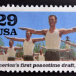 UNITED STATES OF AMERICA - CIRCA 1995: stamp printed in USA dedicated to the Second World War, shows Americas first peacetime draft, circa 1995. — Stockfoto