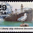UNITED STATES OF AMERICA - CIRCA 1995: stamp printed in USA dedicated to the Second World War, shows First Liberty ship delivered December 30, circa 1995. — Stock Photo
