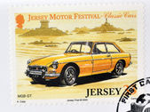 JERSEY - CIRCA 2005: Stamp printed in Jersey dedicated to classic cars, shows MGB GT, circa 2005 — 图库照片
