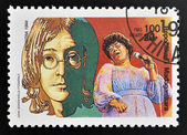 MALAGASY REPUBLIC - CIRCA 1994: A stamp printed in Madagascar shows John Lennon (1940-1980), Ella Fitzgerald (1917-1996), circa 1994 — Stock Photo