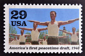 UNITED STATES OF AMERICA - CIRCA 1995: stamp printed in USA dedicated to the Second World War, shows Americas first peacetime draft, circa 1995. — Stock Photo