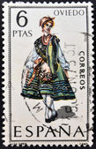 Spanien - omkring 1969: en stämpel som tryckt i Spanien tillägnad provinsiella kostymer visar en kvinna från oviedo, omkring 1969 — Stockfoto